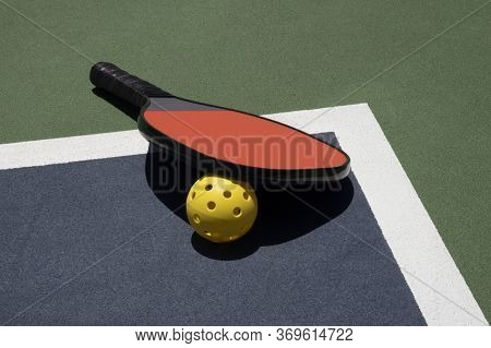 Pickleball Time Out With Ball And Paddle On Court