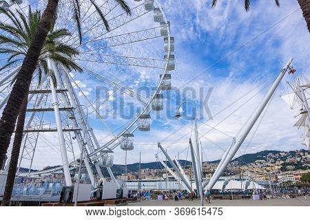 Genoa, Italy - August 20, 2019: Il Grande Bigo And Ferris Wheel In Porto Antico Di Genova Or Old Por