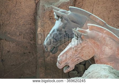 Xian, China - May 1, 2010: Terracotta Army Museum And Hall.  Closeup Of Red And Gray Horse Heads At