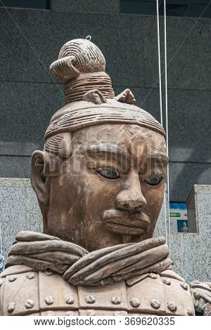 Xian, China - May 1, 2010: Terracotta Army Museuml.  Face Closeup Of Giant Light Brown Sculpture Of