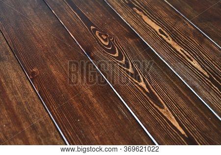A Close Up Of A Hard Wood Floor