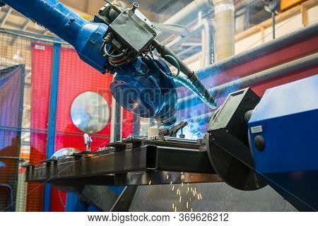 Welding Robot In The Process. Modern Welding Production.