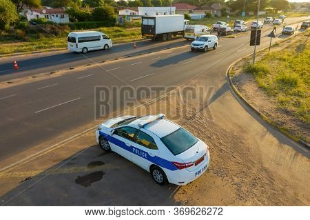 aerial view of a police and ambulance car at a road block, in Africa , Botswana