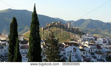 Arabic Castle Among White Houses In Village Of Alora Andalusia