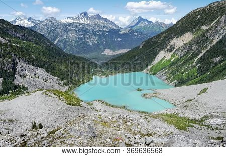 Alpine Turquoise Glacial Upper Joffre Lake In A Valley Between The Mountains On A Sunny Summer Day.