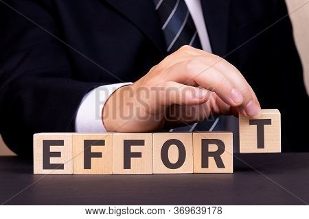 Man Made Word Effort With Wooden Blocks. Business Concept.