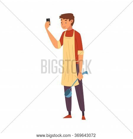 Male Cook Wearing Apron Standing With Ladle Taking Selfie Photo, Male Character Photographing Himsel