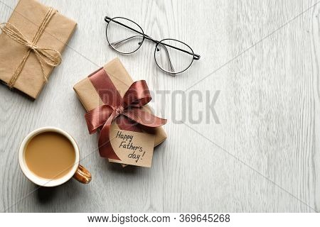 Happy Father's Day Concept. Flat Lay Composition With Gift Box, Cup Of Coffee, Glasses On Wooden Bac