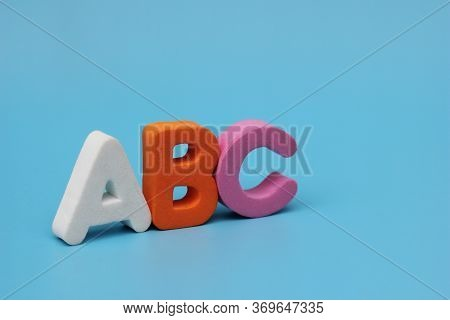 The Color Letters Of The Abc Are Isolated On A Blue Background. Learning Foreign Language. English F