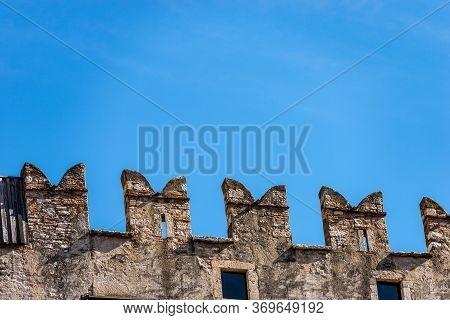 Castello Del Buonconsiglio Or Castelvecchio Medieval Castle In Trento City. Closeup Of Crenellations