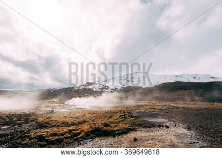 Geyser Valley In The Southwest Of Iceland. The Famous Tourist Attraction Geysir. Geothermal Zone Hau