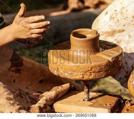 Hands Of A Man Sculpt Clay Dishes. The Ancient Method Of Making Dishes.