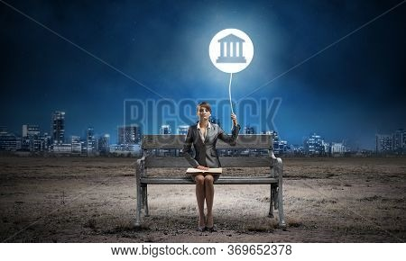 Young Woman With Open Book On Wooden Bench Outdoor. Legal Assistance And Representation. Beautiful G