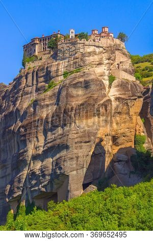 View Of The Orthodox Varlaam Monastery In Meteora, Greece On High Mountain Rock And Blue Sky Backgro