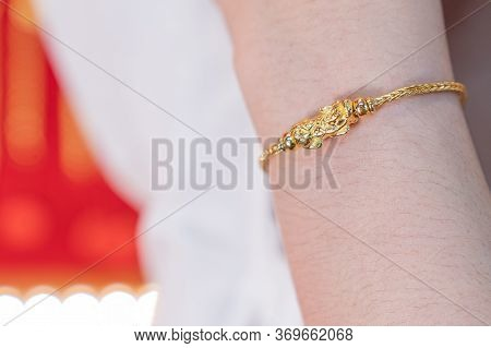 Luxury Gold Bracelet, Golden Dragon Pixiu Or Pi Yao On Arm Background. Traditional Of China For Weal