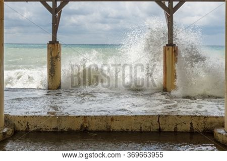 Powerful Waves Crashingagainst Waterfront Concrete Building During The Storm On Black Sea Coast