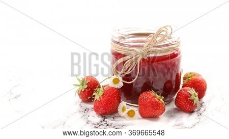 strawberry jam in jar and fresh fruit