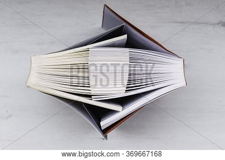 Interlaced Books Suggesting A Hug On A Wooden Table Conceptual Of Love, Romantic Love, Love Of Readi