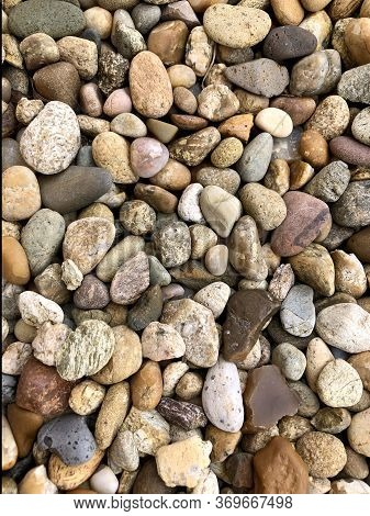 Round Pebbles. Multicolored Colorful Pebbles. Texture Background.