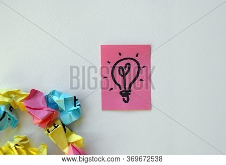 On The Pink Sheet Is Painted A Lamp As A Symbol Of Ideas And Insight. White Background, Design Eleme