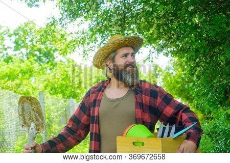 Bearded Man With Gardening Tools. Attractive Man Working In Garden. Professional Gardener. Gardener