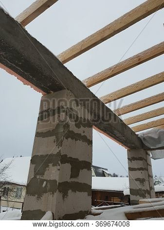 Wooden Rafters Lie On Concrete Beams, Which Are Based On Columns Of Foam Blocks. Preparation Of The
