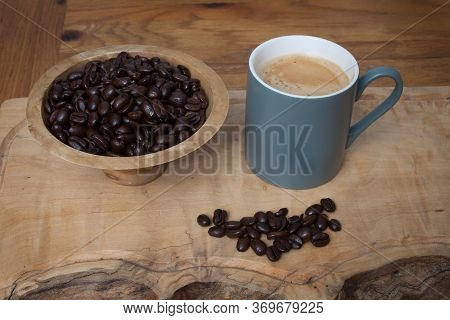 Sumatra Mandeling Coffee Beans And A Cup Of Coffee