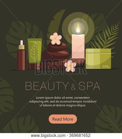 Spa Composition With Bottles Of Cosmetics, Body Oil, Hot Stones, Lotion, Candle And Flowers On Green