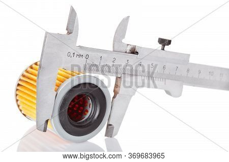 Measurements Of The Size And Diameter Of The Automotive Filter Caliper, Isolated Yellow Part And Cal