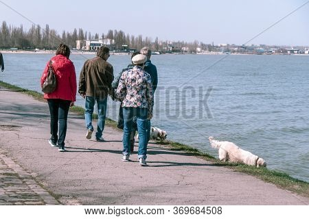 Taganrog, Russia - 07.04.19: A Lot Of People Walk With Their Dogs Along The Promenade. Dog Breeders