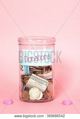 Coins And Banknotes In Glass Money Jar With Label, Financial Donations, Charity, Fund Rising Concept