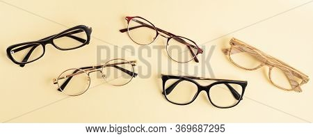 Banner With Collection Of Eyeglasses Over Pastel  Background. Optical Store, Glasses Selection, Eye