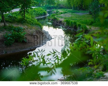 Beautiful City Park. Urban Nature. Park In The City With A Pond And Trees In Sunny Day. City Park Ar