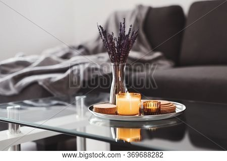 Coffee Table Design Idea: Aroma Candles And Dried Lavender Bouquet On A Metal Tray, Sofa With Grey B