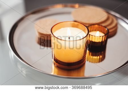 Burning Aroma Candles Of Warm Yellow Color On A Metal Tray. Home Aromatherapy. Simple Decor. Cozy At