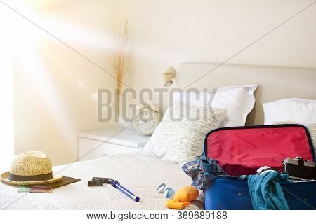 Summer Holiday Travel Accessories Prepared On The Bed And Mask For Holiday Travel In Coronavirus Sea