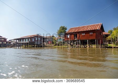 Floating Village House Along Inle Lake In Burma