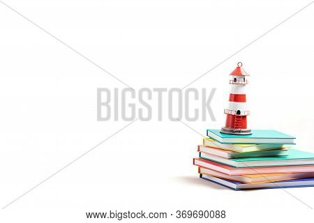 Lighthouse Standing On The Pile Of Books. International Literacy Day, Adventures In Books, Imaginati