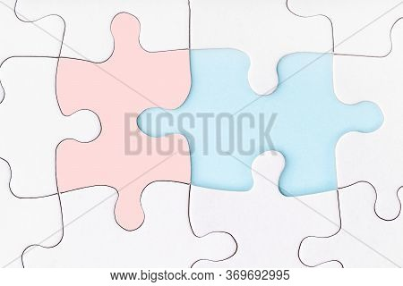 Male And Female Pieces Of Puzzle Matching Each Other. Missing Piece Of Jigsaw Puzzle On Blue Backgro