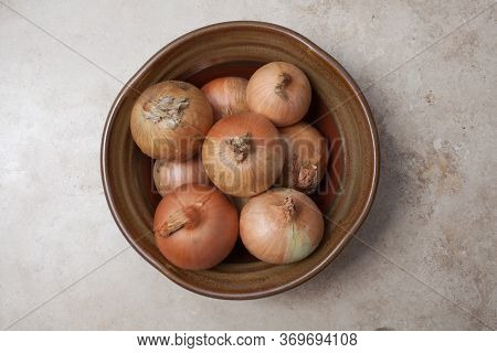 Bulb Onions Or Common Onions In A Rustic Pot