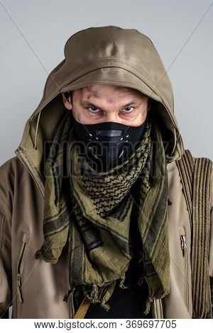 Young Handsome Man Wearing Black Protactive Face Mask And Jacket With Hood On Gray Background
