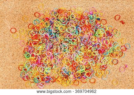 Colored Rubber Bands In The Background, Collection Of Elastic Bands