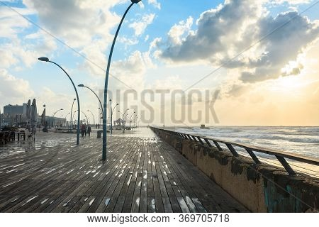 Tel Aviv, Israel - November 22, 2014: People Walking On The Tel Aviv Promenade On The Sunset.