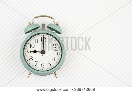 Flat Lay With Vintage Alarm Clock Over The Striped Background
