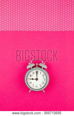 Flat Lay With Vintage Alarm Clock Over The Pastel Background With Polka Dots