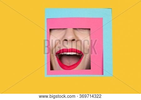 Astonished. Face Of Emotional Caucasian Woman Peeks Throught Square In Yellow Background. Trendy Geo