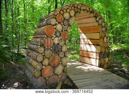 Wooden Arch In A Forest Road In The Forest Of Gisselfeld Klosters. Denmark