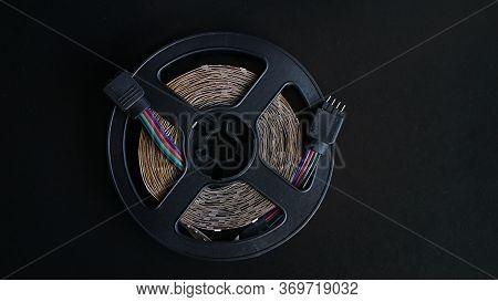 Led Tape Coil. Led Lights Tape On Black Background. Rgb-light Off