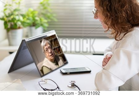 telemedicine concept elderly woman in an online consultation