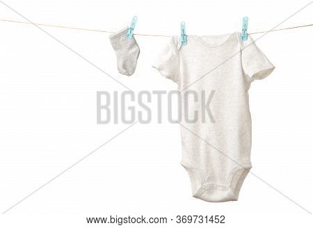 Baby Clothes Hanging On The Clothesline Isolated On White. Top View